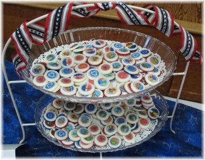 Eagle Scout merit badges.    Took it to a grocery store to print edible images. Put them face down in a thin mint choc mold and covered with white candy melts. Pop them out and you have badges!