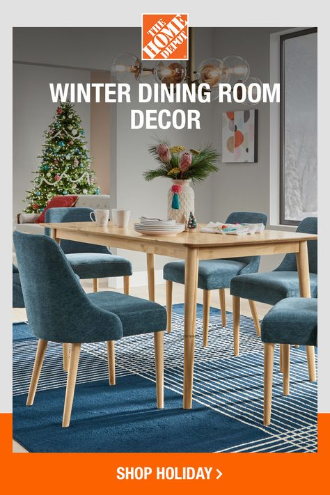 If classic Christmas reds aren't your cup of tea, try amping up the pastels, brights or jewel tones instead. Blue velvet chairs and a thick area rug add warmth, while pops of coral and rose gold accents catch your attention. Shop all winter dining decor now online at The Home Depot.