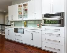 Modern, White, Flat Front Kitchen Cabinets With Long Sleek Handles