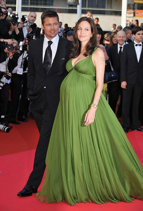Angelina Jolie Photos - Actors Angelina Jolie and Brad Pitt attend the
