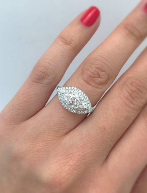 A SkinnyBling Engagement Ring that will show her how unique she really is! ************************************************************************************************* This stunning engagement ring features a GIA certified 1.00ct. marquee shaped diamond center stone in a beautiful