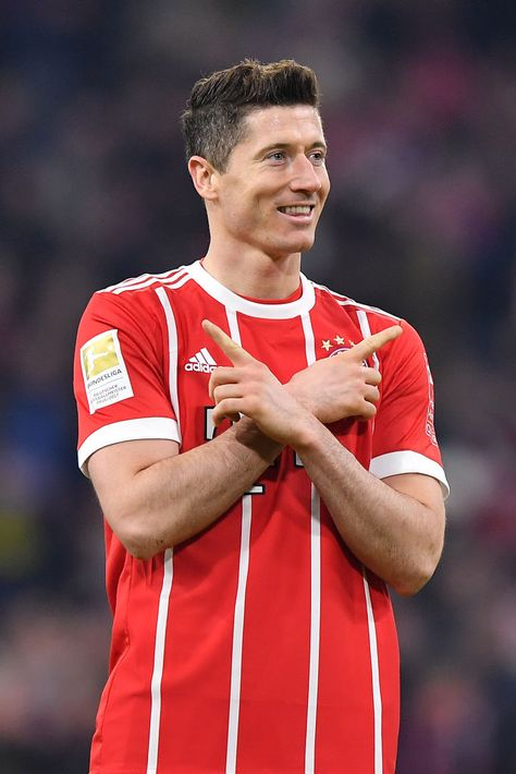 MUNICH, GERMANY - MARCH 31: Robert Lewandowski of Bayern Muenchen celebrates after he scored to make it 6:0 during the Bundesliga match between FC Bayern Muenchen and Borussia Dortmund at Allianz Arena on March 31, 2018 in Munich, Germany. (Photo by Sebastian Widmann/Bongarts/Getty Images)