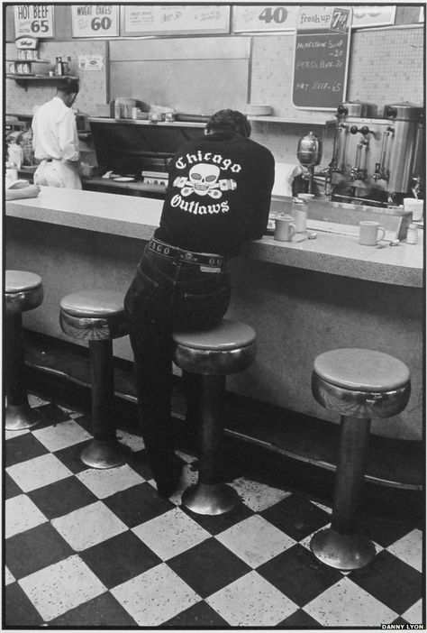 Vintage Motorcycles Jack, Chicago, Danny snaps a member perching on a stool at a diner - Photographer Danny Lyon got up close and personal with the Chicago Outlaws Motorcycle Club between 1963 and Outlaws Motorcycle Club, Motorcycle Clubs, Biker Clubs, Rockabilly Pin Up, Rockabilly Fashion, Outlaws Mc, Pinup, Rock And Roll, Club Usa