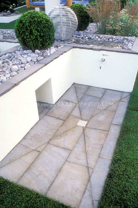 Backyard with pets in mind: Great problem solving idea to use sloped hillside cut to create dog washing shower area of deck patio for pet washing in family outdoor space with patio.