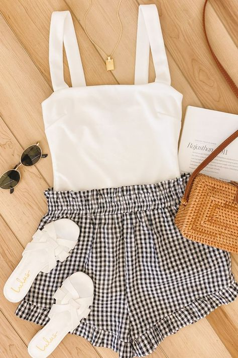 A cute outfit for everyday! Lulus Pretty Playful Black and White Gingham Ruffled Shorts and Symbolize White Sleeveless Bodysuit are the perfect staples. #lovelulus