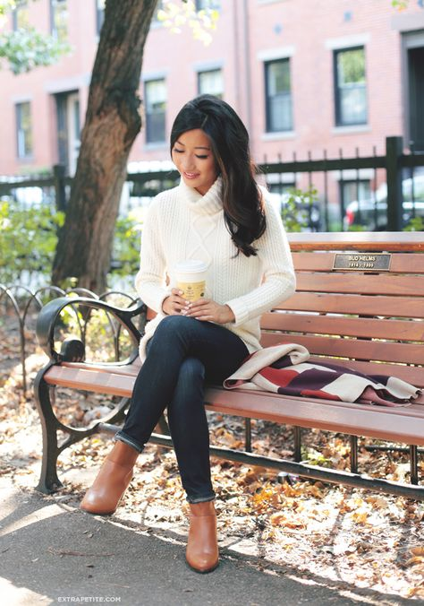 Casual Autumn outfit idea: cable turtleneck cream sweater, skinny jeans, brown booties