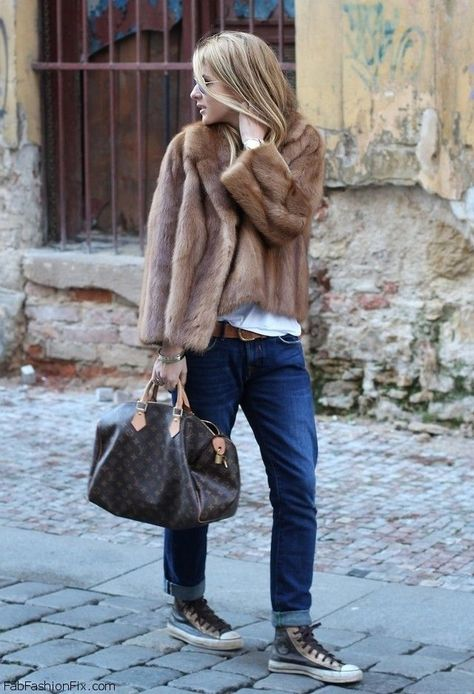 Team a brown fur jacket with dark blue boyfriend jeans for a casual level of dress. Mix things up by wearing dark grey leather high top sneakers.  Shop this look for $328:  http://lookastic.com/women/looks/sunglasses-watch-jacket-crew-neck-t-shirt-belt-bracelet-tote-bag-boyfriend-jeans-high-top-sneakers/5427  — Grey Sunglasses  — Gold Watch  — Brown Fur Jacket  — White Crew-neck T-shirt  — Brown Suede Belt  — Gold Statement Bracelet  — Dark Brown Print Leather Tote Bag  — Navy Boyfriend ...