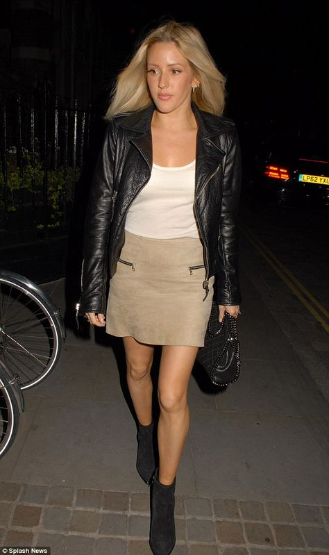Stylish outing: Ellie Goulding donned a suede miniskirt to party the night away at the Chi...