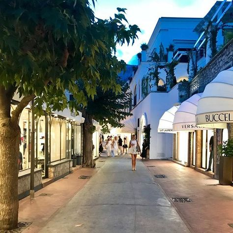 CAPRI ITALY My husband captured this shot of Via Camerelle in Capri perfectly. Luxury brand shops complete with women strolling in white linen outfits #socapri #whitelinen #luxuryshopping #italianstyle