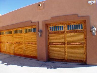 Southwest Garage Doors Are Covered With Split Dry Latillas Sticks Hand Hewn Cedar Frames The Latilla Sticks Southwestern Doors Hand Hewn Beams Exterior Decor