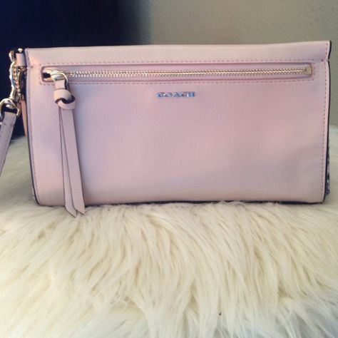 755c5692479e Coach clutch wristlet Light colored leather clutch--good condition-never  been used. Minor leather ceasing on front of bag-pictured. Animal print- snake on ...