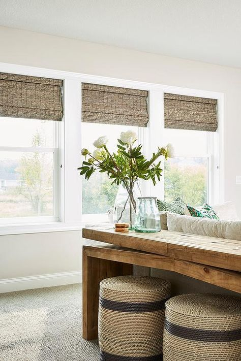 tisch von oben Natural light streams in from windows covered in bamboo roman shades and positioned facing a salvaged wood sofa table placed above natural woven stools and behind a cream sectional. Bamboo Roman Shades, Woven Wood Shades, Wood Sofa Table, Behind Sofa Table, Console Table, Best Leather Sofa, White Leather, Couch Set, Living Room Ideas
