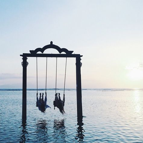 A swing over the placid sea, the shape and feeling of a temple gate.. Gili Islands, Bali