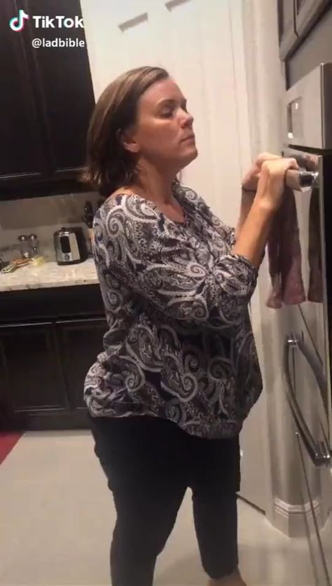 Funny mum with her squeaky oven dance