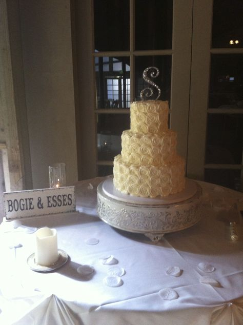 Three tier buttercream rosette wedding cake on a vintage cake stand with a monogram topper. http://deliciousartistry.com/index.html