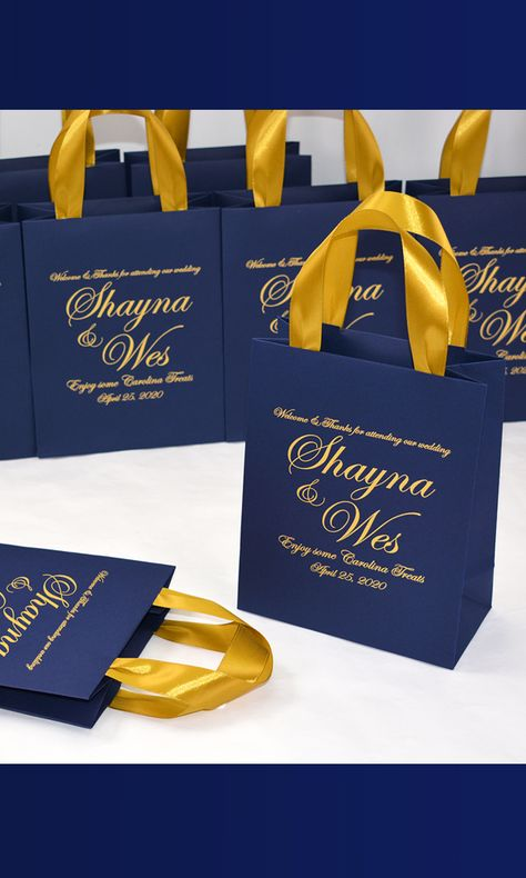 Navy Blue Wedding Welcome bags with gold satin ribbon handles and your names. Elegant Personalized Wedding gifts and favors for guests. #weddingbags #weddingwelcomebags #welcomebags #weddingwelcome #weddingfavor #giftbags #partyfavor #weddingfavor #weddingfavors #weddingfavour #personalizedgift #weddingwelcome #weddingparty #weddingdecor #elegantwedding #thankyoutag #destinationwedding #welcomeletter #bluewedding #blueweddingdecor #mrandmrs #elegantparty #navybluewedding #goldwedding