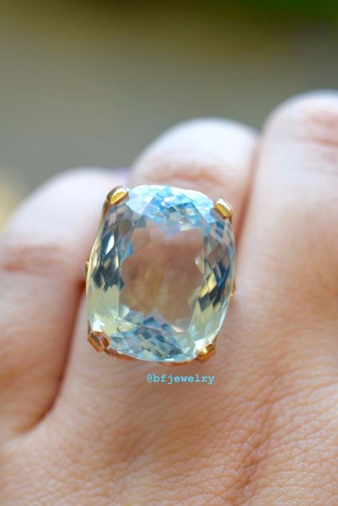 The amazing center stone is a cushion cut sky blue topaz, weighing a whopping 27.58 carats. Stone: Diamond And Sky Blue Topaz. Sky Blue Topaz Weight: 27.58 Carats, 20x16 mm. The amazingly detailed setting is made of 14k rose gold. | eBay!