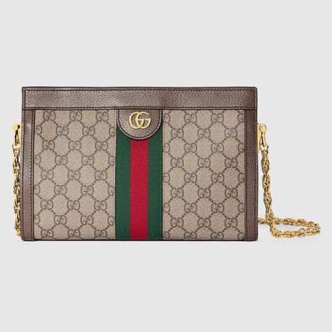 Shop the Ophidia GG small shoulder bag by Gucci. Crafted in GG Supreme  canvas with inlaid Web stripe detail 337c2ae20cc
