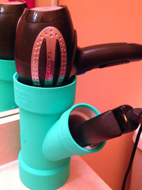 Use PVC piping to hold your hair styling devices. For all the girls out there!