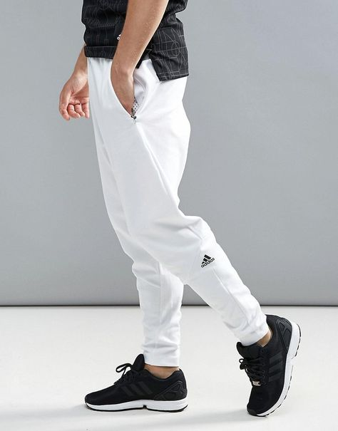 Adidas ZNE Joggers In White Klick to see the Price #men