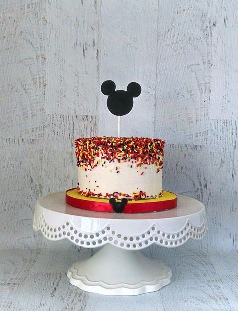 This is a smash cake with sprinkles in Mickey Mouse colors. Inspired by the Mickey Mouse Sprinkle Cake by Topsy Turvey. Mickey Mouse Smash Cakes, Mickey Mouse Clubhouse Cake, Mickey Mouse Clubhouse Birthday Party, Mickey Cakes, Minnie Birthday, 2nd Birthday, Mickey Mouse Theme Party, Mickey And Minnie Cake, Minnie Mouse