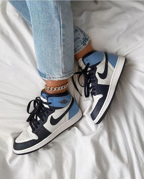 The Air Jordan 1 High Obsidian/University Blue is a 2019 release of the legendary silhouette in a colorway inspired by Michael Jordans college career in the University associated with North Carolina. Sneakers Mode, Sneakers Fashion, Fashion Shoes, Air Max Sneakers, Shoes Sneakers, Nike Fashion, Kd Shoes, Fashion Fashion, Fashion Clothes