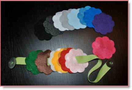 Felt Flowers Button Snake - help kids with their buttoning skills.