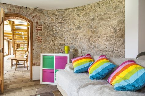 The children's den is decorated with bright rainbow cushions and furniture...  #wealdentimesinteriors