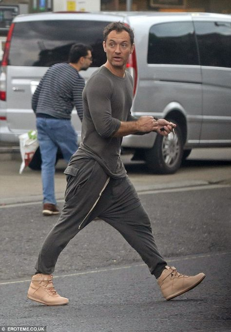 Casual look: It seems Jude Law might have taken some sartorial tips from model son Raffert...