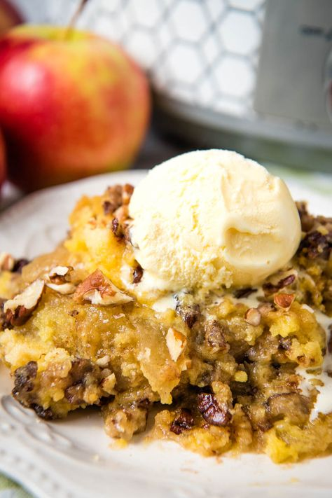 Layer a CrockPot apple dump cake with pie filling, cake mix, and cinnamon. Easy slow cooker recipe, festive for fall and the holiday season! #appledumpcake #dumpcake #applerecipes #crockpot #slowcooker #easydesserts #fallrecipes
