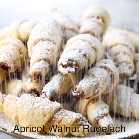 This is perhaps the easiest rugelach recipe you'll ever come by. Each flakey layer is loaded with apricot jam and chopped walnuts. #rugelach #jewishcookies #christmascookies #holidaycookies #pastry