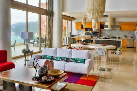A wide array of patterns and textures are tied together with a fun, bright color scheme in this gorgeous penthouse at Garza Blanca Preserve Resort & Spa in Puerto Vallarta #CousinsOnCall