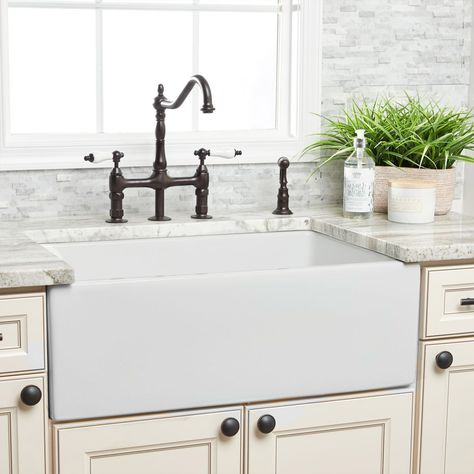 Make the kitchen sink the focal point of your kitchen with a beautiful farmhouse sink. Constructed of heavy-duty fireclay, this farm sink was hand-poured in Italy. The non-porous surface is resistant to heat. Add a sink grid to the bottom to protect your new farmhouse sink from scratches and normal wear and damage. Farmhouse Apron Sink, Fireclay Farmhouse Sink, Fireclay Sink, Farmhouse Kitchen Decor, Farmhouse Style, Rustic Farmhouse, White Farmhouse Sink, Farmhouse Interior, Farmhouse Ideas