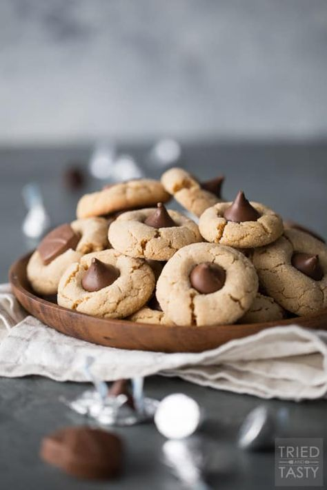 Close up photo of peanut butter cookies with Hershey kisses pressed on top