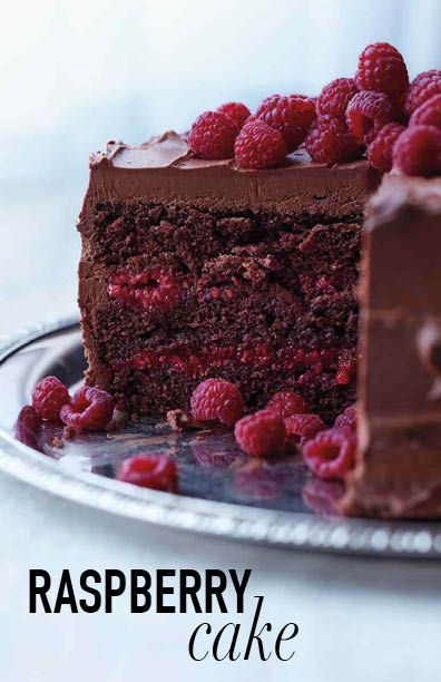 Chocolate-Raspberry Cake Martha Stewart Living - This beauty is baked with a splash of Chambord and layered with a sweet raspberry filling, both of which offer bright counterpoints to the thick layer of chocolate-cream cheese frosting and whole berries Just Desserts, Delicious Desserts, Dessert Recipes, Frosting Recipes, Health Desserts, Easter Recipes, Chocolate Raspberry Cake, Cake Chocolate, Raspberry Cake Filling