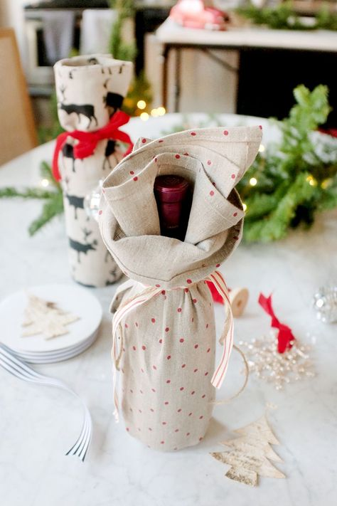 Ditch the Wine Bag: 3 Creative Ways to Gift a Bottle of Wine - The Everygirl Raise your hand if you agree: November went by way too quickly. I don't know where the month went Wine Bottle Gift, Wine Gifts, Wine Gift Bags, Wine Bottle Wrapping, Christmas Wrapping, Christmas Gifts, Christmas Music, Wrapped Wine Bottles, Wine Gift Baskets