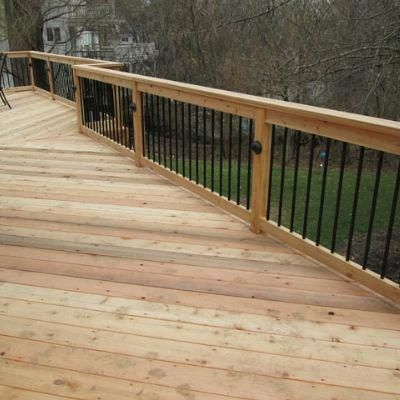 This Deck Features Unique Design Features For A Traditional Yet Contemporary Look Natural Cedar Wood Was Used Fo Building A Deck Backyard Views Deck Railings
