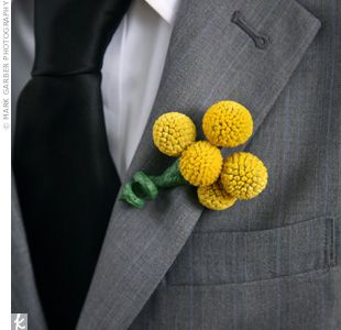 "Each boutonniere was a cluster of craspedias. ""They're so much more masculine than a rose bud,"" says Amber."