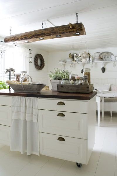 The kitchen, preparation. The wooden lamp is made of an old log from the house.