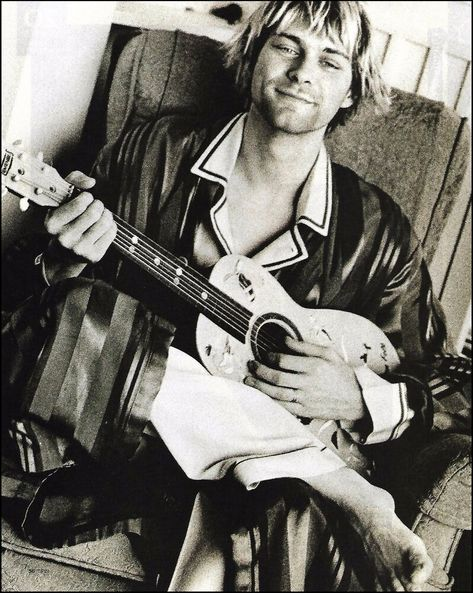 Nirvana Kurt Cobain with little toy guitar 8 x 11 b/w pin-up photo clipping