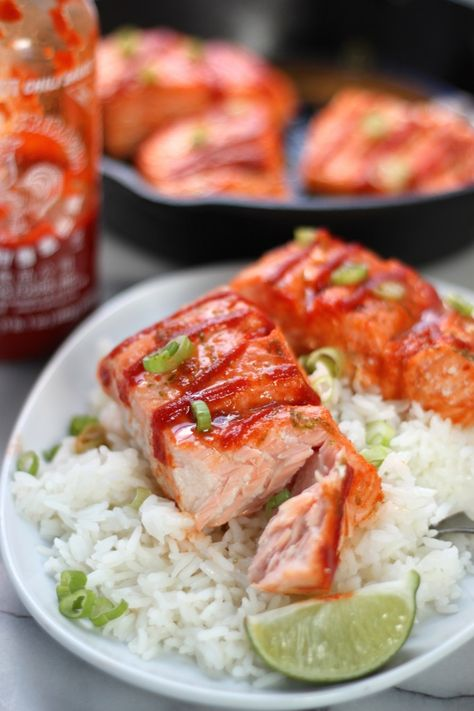 Sweet and Spicy Sriracha Baked Salmon - This flavorful salmon only takes 20 minutes start to finish! Flaky and perfectly cooked!