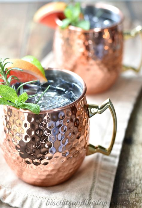 This tangy twist on the classic Moscow mule with fresh grapefruit and rosemary is just what you need to sip on this weekend! #springcocktail #spring #cocktails #grapefruit #outdoorparty #vodka #lime #spicy #moscowmule