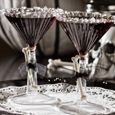 Bad to the bone! Black vodka martinis with black raspberry liqueur and rock candy rims. <3 these for a black-n-bone Halloween party!