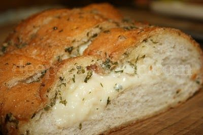 Cheesy Garlic Bread - A decadent buttery garlic French bread stuffed with gooey cheese and sprinkled with garlic powder and parsley. An indulgence for sure.