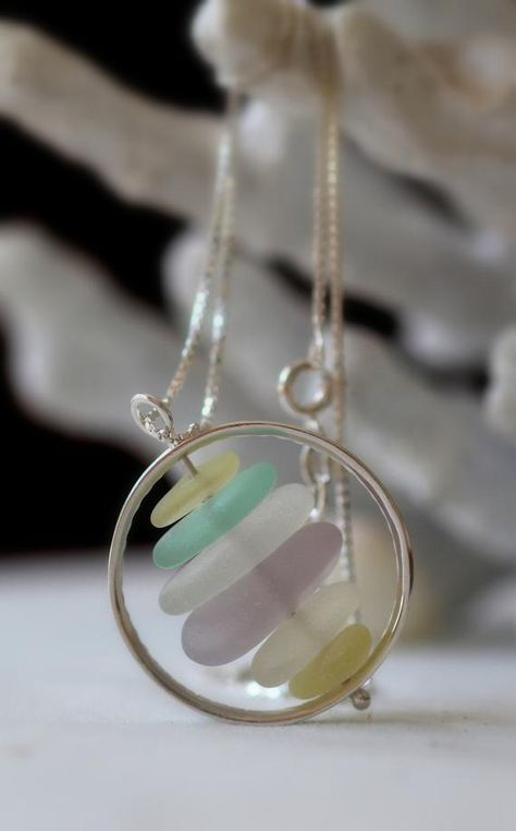 A striking sea glass necklace featuring six pieces of genuine sea glass in lovely pastels, framed in a sterling silver hoop. Our Wheelhouse pendant hangs on a sterling silver box chain, length of your choosing so that you can wear your necklace high or low. Our sea glass jewelry is presented boxed,
