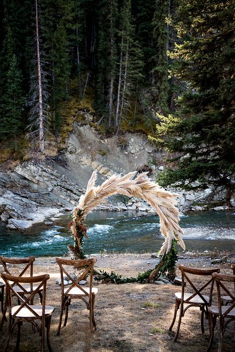 Pampas Grass Circular Ceremony Arbor Frames The Rocky Mountain River ~ Creative Edge Flowers; Paisley Photography Pampas Grass Circular Ceremony Arbor Frames The Rocky Mountain River ~ Creative Edge Flowers; Bohemian Wedding Decorations, Boho Wedding, Rustic Wedding, Dream Wedding, Wedding Day, Wedding Bride, Woods Wedding Ceremony, Ceremony Decorations, Pagan Wedding