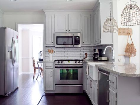 5 Tricks to Make Your Kitchen Look and Feel Bigger: Keep the Personal Touches Small.  Display simple items that don't create a feel of clutter.