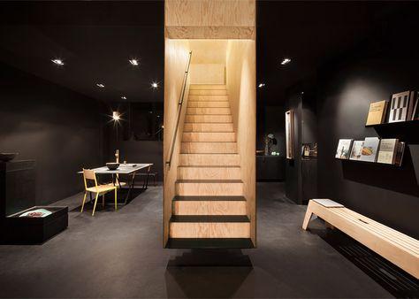 Box-like staircase forms a centrepiece inside Bazar Noir concept store.