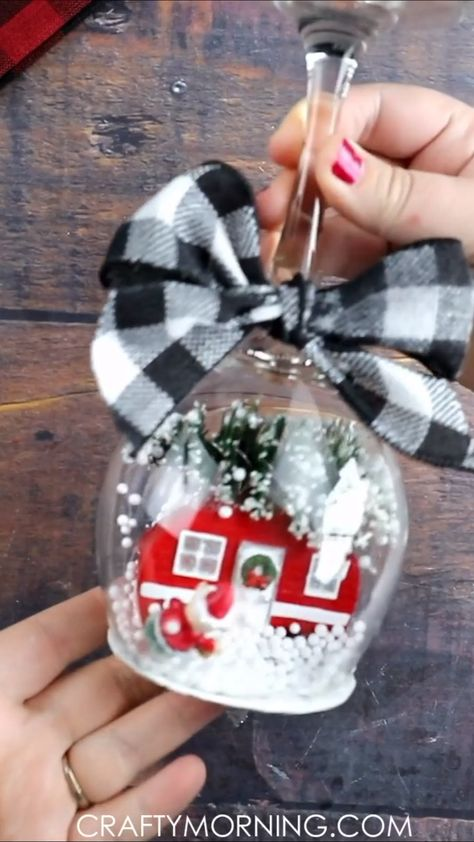 Wine Glass Snow Globe Candle Holders- cute Christmas DIY project/ craft idea to make! They make adorable christmas home decor pieces or even gifts! Fill with any camper ornament or figurines. Step by step instructions how to make a wine glass candle holder.