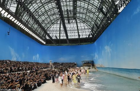Working it! The models were seen storming the sand and water covered runway, whilst guests... #fashionweek #models #chanel #parisfsahionweek